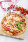 Home made italian pizza with salami and tomato — Stock Photo