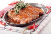 Marinated pork chops in a pan — Stock Photo