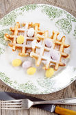 Waffle with easter egg on a plate — Stock Photo
