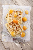 Waffle with apricots and almond splinters — Stock Photo