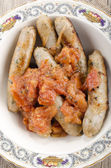 Italian spicy sausages with tomato — Foto de Stock