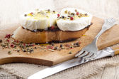 Buffalo mozzarella on oven toasted bread — Stockfoto