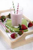 Strawberry milkshake on a serving tray — Foto de Stock