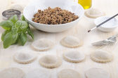 Home made ravioli on wooden table — Stockfoto