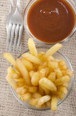 French fries and spicy tomato sauce — Stock Photo