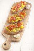 Bruchetta with tomato and basil — Stock Photo