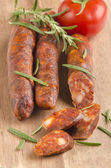 Sliced spanish chorizo with rosemary — Stock Photo