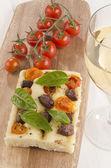 Mediterranean flat bread on wooden board — Stock Photo