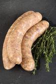 Grill sausage with herbs in natural casing — Stock Photo