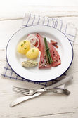 Pink herring with potato and herb butter — Stock Photo