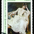 Stock Photo: Vintage postage stamp. Seated Woman, by R. Mandrazo.