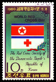 Vintage  postage stamp.  Emblem of DPRK Red Cross. — Stockfoto
