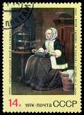 Старинные почтовая марка. девушка на работе, на Габриель Метсю. — Стоковое фото
