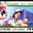 Vintage postage stamp. Baby physician and child. — Stock Photo #48779677