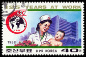 Vintage  postage stamp. Baby physician and child. — Stockfoto