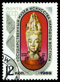 Vintage  postage stamp. Head of goddes Kannon. — Stock Photo