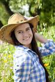 Young woman in cowboy hat — Stock Photo