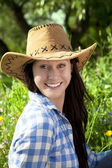 Smiling woman in cowboy hat — Stock Photo