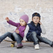 Kids on a skateboard — Stock Photo