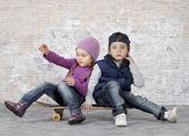 Kids on a skateboard — Stock Photo