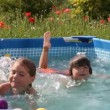 Kids have fun swimming in a pool with nice blue water — Stock Video #23598703