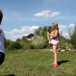 Kids play with soap bubbles outdoors — Vídeo de stock