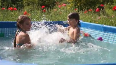 Kids have fun swimming in a pool with nice blue water — Stock Video