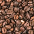 Roasted coffee beans background - Foto Stock