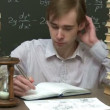 Stock Video: Student is learning his homework