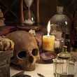 Alchemy still life with skull — Stock Photo #25611895