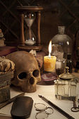 Alchemy still life with skull — Stock Photo
