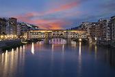 Ponte Vecchio bridge at sunset. Florence, Italy — Stock Photo