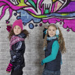 Girls with spray can and wall — Stock Photo