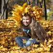 Girl sitting in autumn leaves — Stock Photo