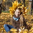 Little girl with autumn leaves — Stock Photo