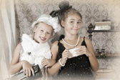 Retro style portrait of two little girls — Stock Photo