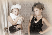 Vintage style portrait of two little girls — Stock Photo