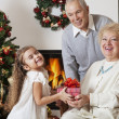 Grandparents, grandchildren and presents — Stock Photo