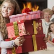 Happy little girl getting Christmas presents — Stock Photo