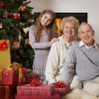 Grandparents and granddaughter celebrating Christmas — Stok fotoğraf