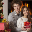 Cheerful couple with Christmas presents — Stock Photo