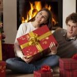 Young couple celebrating Christmas holidays — Stock Photo