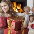 Happy little girl with Christmas presents — Stockfoto