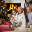 Grandparents with grandchildren celebrating Christmas — Foto Stock