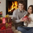 Stock Photo: Young Caucasian couple with Christmas presents