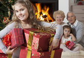 Happy little girl with Christmas presents — Stock Photo