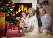Grandparents with grandchildren celebrating Christmas — Stock Photo