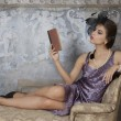 Beauty brunette model reading book — Stock Photo #39954497
