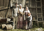 Vintage styled portrait of countryside family — Stock Photo