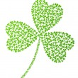 Vector shamrock made of small shamrocks — Stockvektor